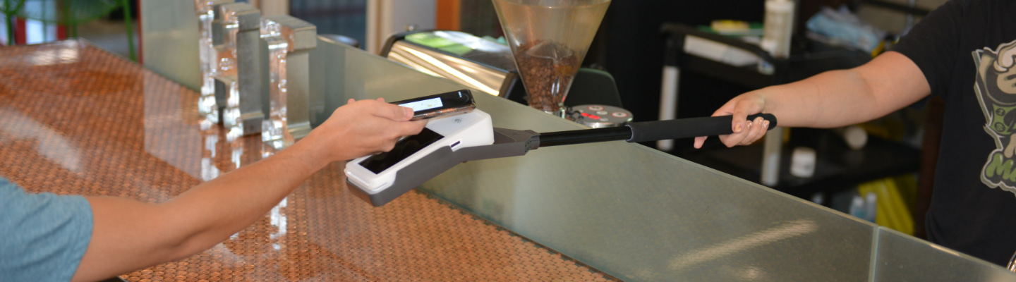 Merchant taking customer payment with Clover Flex